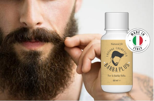uomo che gioca con la sua barba